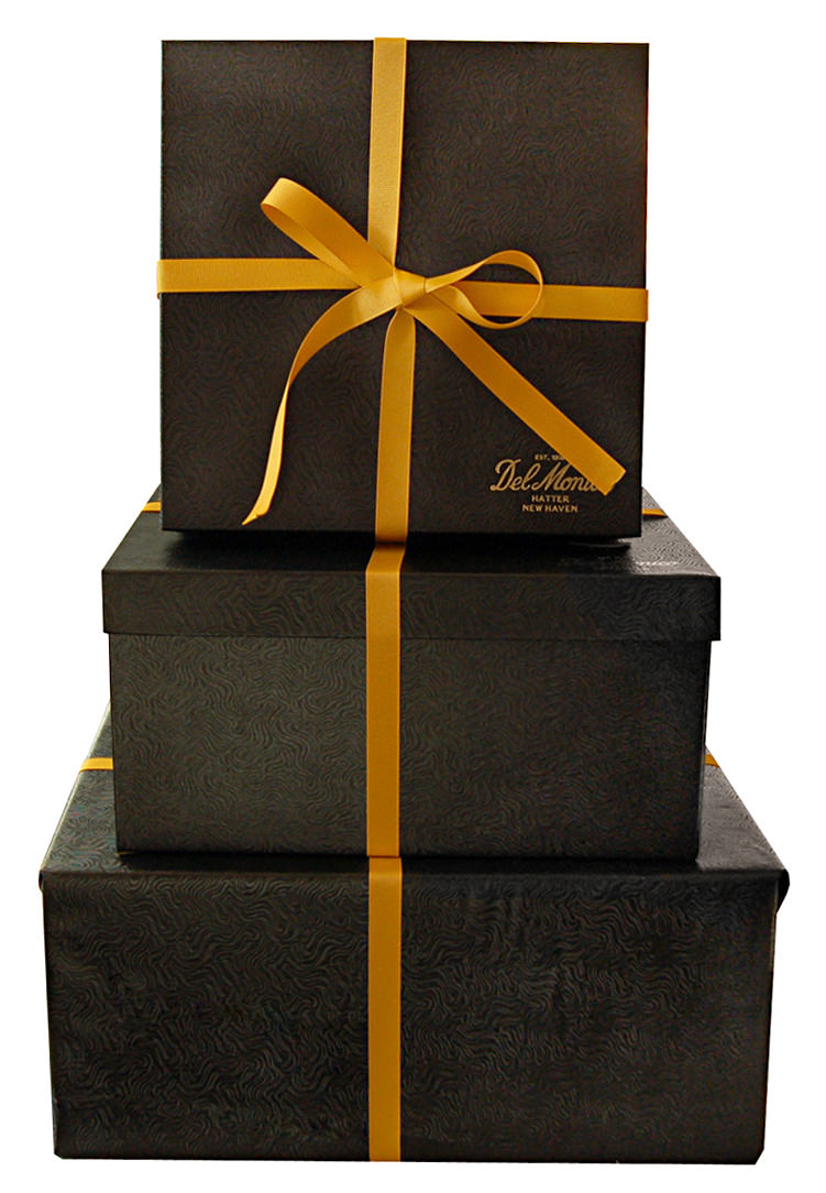 Gift wrapping is the act of enclosing a gift in some sort of material. Wrapping paper is a kind of paper designed for gift wrapping. An alternative to gift wrapping is using a gift box or bag. A wrapped or boxed gift may be held closed with ribbon and topped with a .